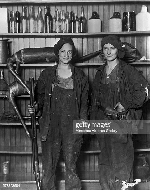 Two sisters, Florence Friermuth and Susie Friermuth Doffing, pose in their guarding positions after they were arrested for moonshining. The sisters...
