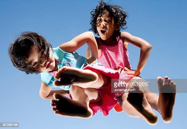 two sisters have attitude.  - soles pose stockfoto's en -beelden