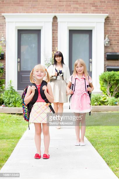 two sisters heading back to school