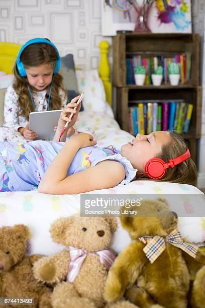 Two sisters in bedroom