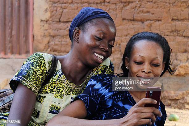 Two sisters in telephone communication