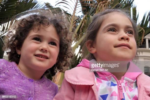 Two sisters looking away