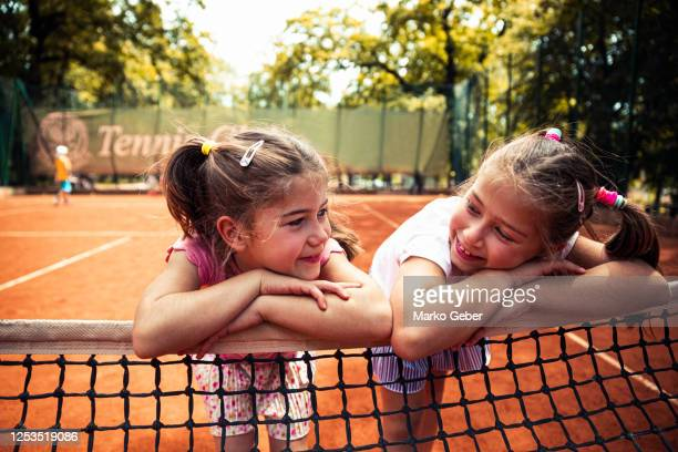 two sisters playing tennis - belgrade serbia stock pictures, royalty-free photos & images