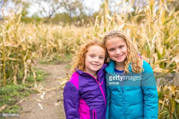 Two Sisters Side By Side in Corn Maze