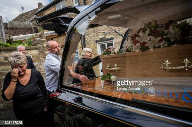 Two sisters, Tricia Tattershall left, and Christine Baker right , say goodbye to their only brother, Eric Hallett outside Wakely & Sons Funeral Home...