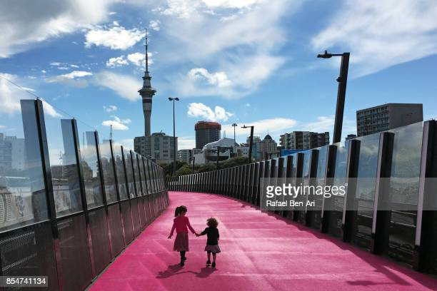 Two sisters walking together in Auckland city