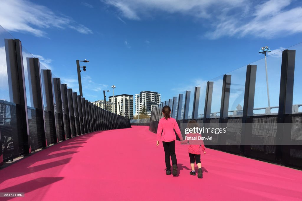 Two sisters walking together in Auckland city : Stock Photo