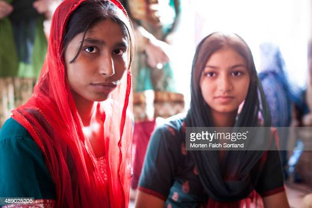 Two sisters wearing saris at the Jama Masjid Mosque in Delhi, India