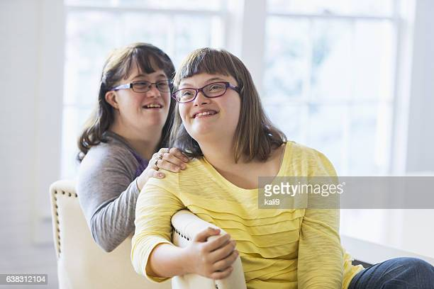 two sisters with down syndrome - down syndrome stock pictures, royalty-free photos & images