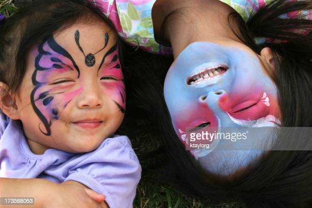 Two sisters with their faces painted