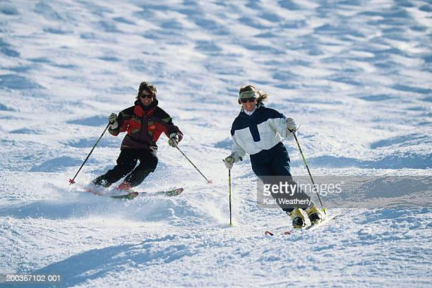 Two skiers in moguls, Squaw Valley, California, USA