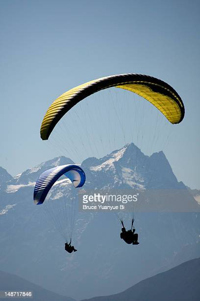 Two skydivers flying over Seefeld valley.