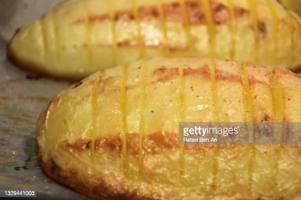two sliced roasted potato - rafael ben ari bildbanksfoton och bilder