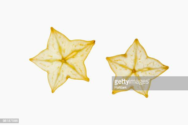 Two slices of an organic carambola on a lightbox