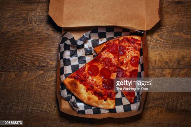 Two slices of pepperoni pizza in a Wiseguy Pizza box