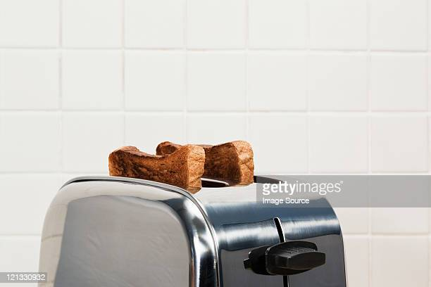 two slices of toast in toaster - routine stock pictures, royalty-free photos & images