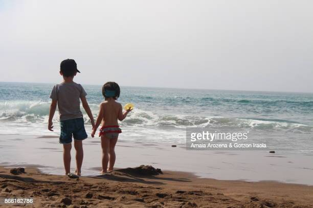Two small brothers at beach