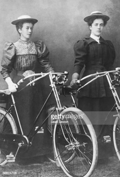 Two smart ladies prepare for a bike ride circa 1910