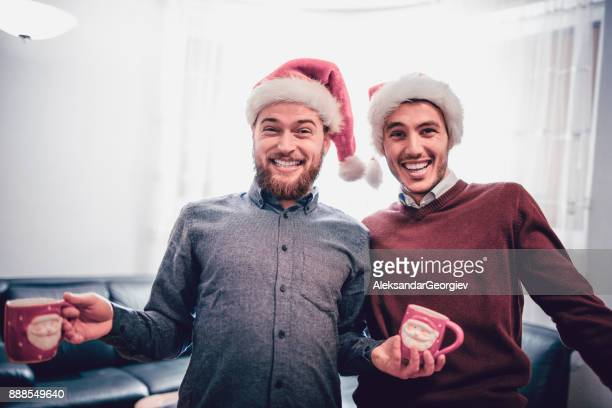 two smiling drunk friends having a funny christmas celebration - eggnog stock photos and pictures