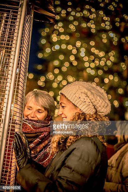 Two Smiling Female Friends and Fire, Night, Christmas, Carinthia, Austria