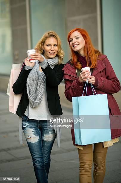 Two smiling woman shopping.