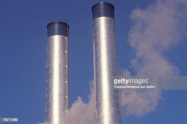 Two smokestacks in industrial America