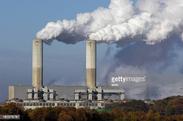 two smokestacks of a power plant - smoke stack stock pictures, royalty-free photos & images