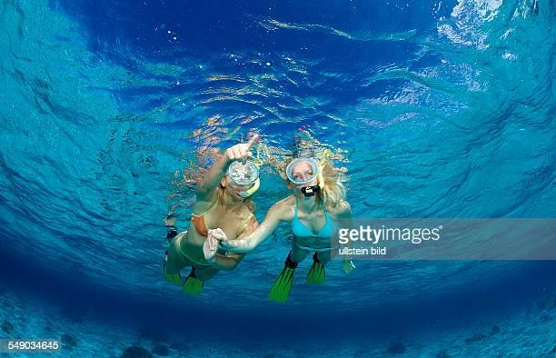 Two snorkeling girls, Komodo National Park, Indian Ocean, Indonesia