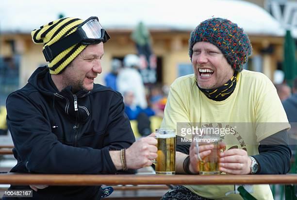 Two snowboarders enjoying Aprés Ski