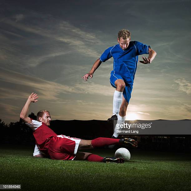 two soccer player fighting for ball  - tackling stock pictures, royalty-free photos & images