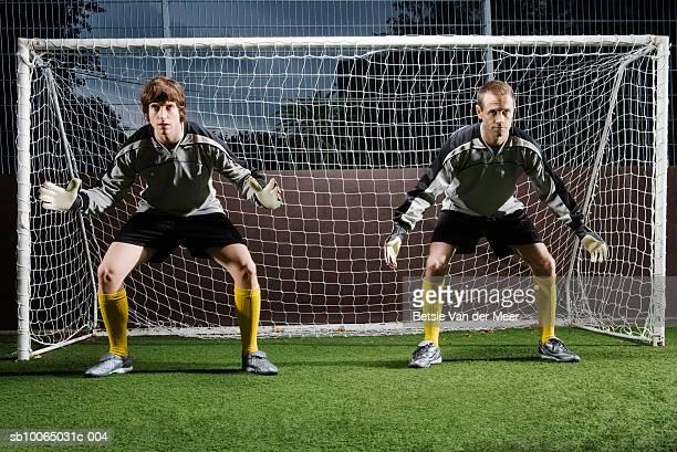 two soccer players defending football goal - デイフェンス ストックフォトと画像