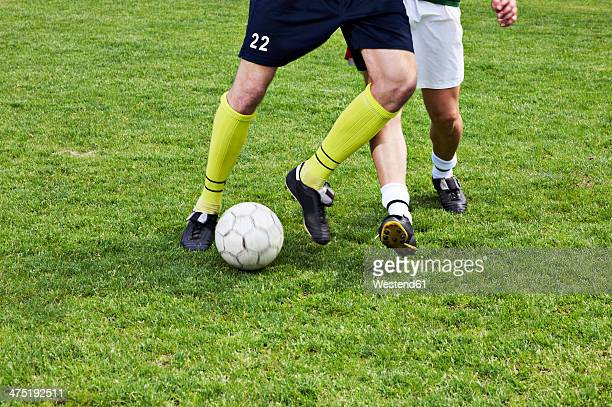 two soccer players on field - defender soccer player stock photos and pictures