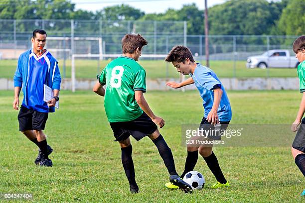 Two soccer players vie for the ball