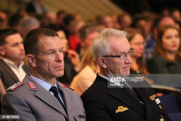 Two soldiers are listening to the panel in Munich Germany on February 15 2018 Today the first panel of the Munich Security Conference was held...