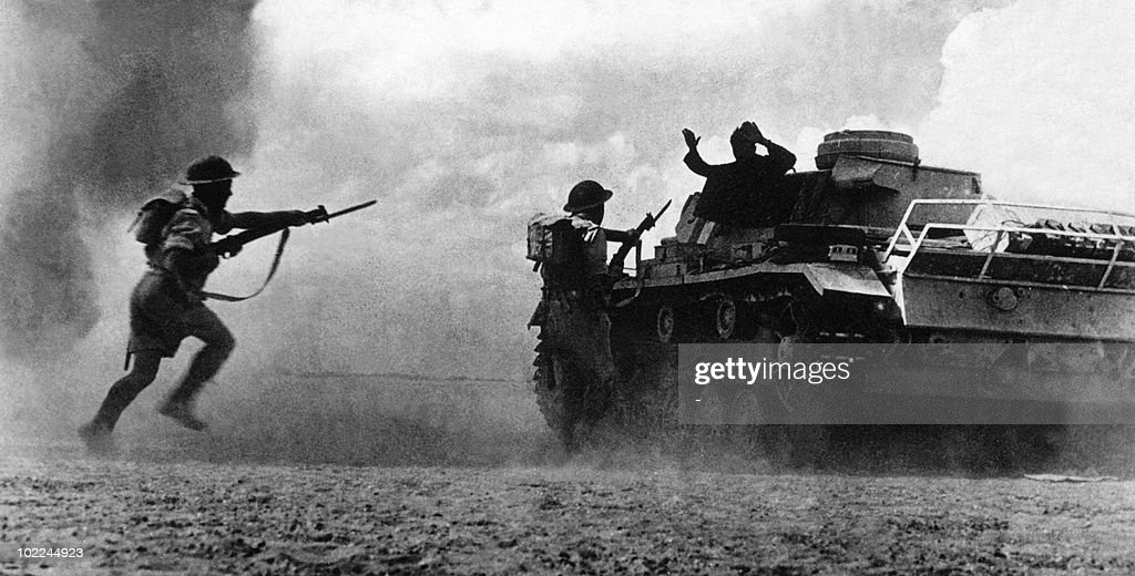 Two soldiers belonging to the Commonwealth and Allied forces aim at a German soldier surrendering atop his tank 25 October 1942 as a sandstorm clouds the battlefield at El Alamein, about 60 miles (100 kilometers) west of Alexandria. The battle at El Alamein, which began 23 October 1942 and ended 12 days later, a culmination of two years of fighting in north Africa between 100,000 German and Italian troops, led by German Field Marshall Rommel and 150,000 Commonwealth and allied forces under the command of British Field Marshal Montgomery, proved a decisive allied victory, helping to establish control in the mediterranean and securing the Suez Canal.