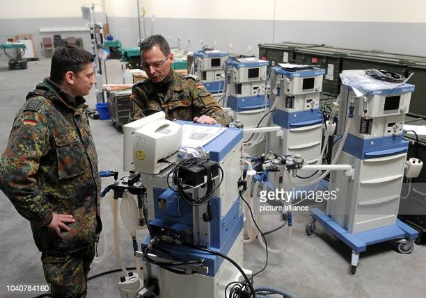Two soldiers from the rapid deployment medical services troups prepares an anaesthesia machine for shipment to Mali in Leer Germany 05March 2013 The...