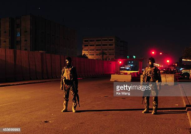 Two soldiers guard at a check point at midnight near the green zone in Bagdad of Iraq during the 23rd Arab League Summit, on March 28, 2012.
