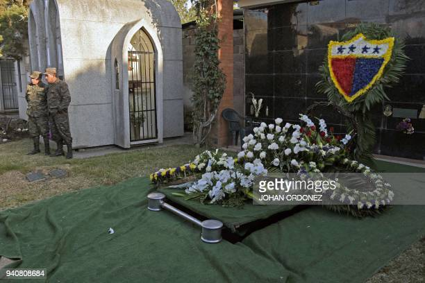 Two soldiers guard the grave of former Guatemalan dictator retired General Jose Efrain Rios Montt in Guatemala City on April 1 2018 Efrain Rios Montt...