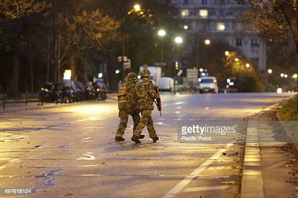 Two soldiers in fatigues and armed with submachine guns guard the area around the Eiffel tower The area around the Eiffel Tower was evacuated after a...