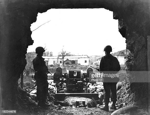 Two soldiers of the 95th Infantry Division of the 3rd US Army look out over the Saar river from the cover of the tunnel entrance near Saarlautern...