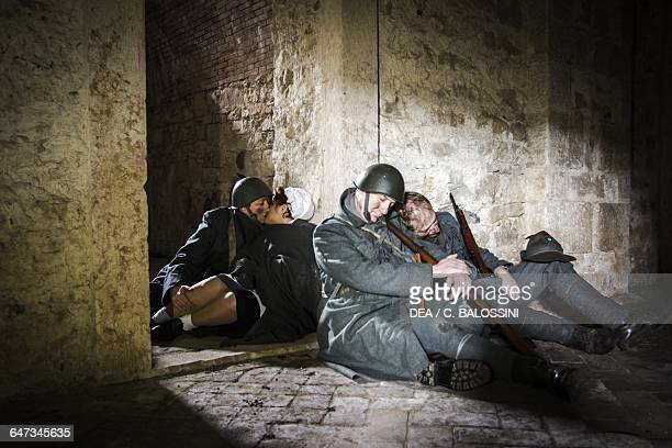 Two soldiers of the 9th Alpine Regiment in a makeshift shelter with a nurse and third Alpine soldier kissing in the background Italian army Russian...