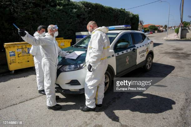 Two soldiers of the Military Emergency Unit and a Civil Guard officer are seen preparing to disinfect the nursing house Edad de Oro at the town of El...