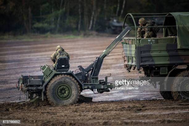 Two soldiers on a mine-laying system 85. Shot during an exercise of the land forces on October 13, 2017 in Munster, Germany.