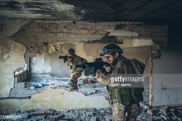 two soldiers on a mission in abandoned building - special forces stock pictures, royalty-free photos & images