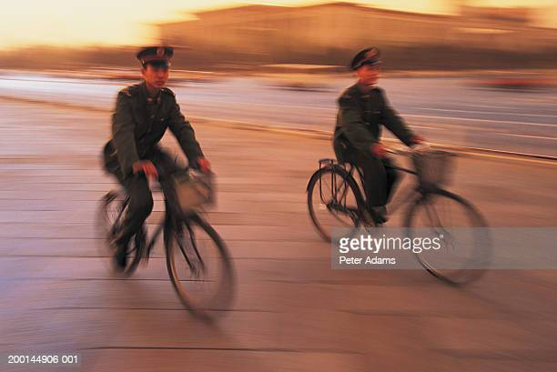 Two soldiers on bicycles (blurred motion)