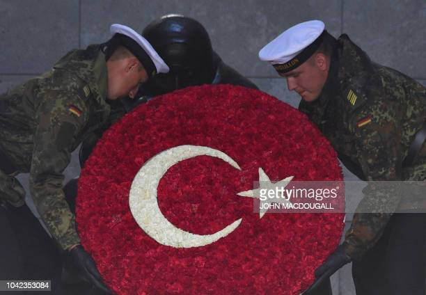 Two soldiers practise laying a wreath at the Neue Wache memorial for the victims of war and dictatorship ahead a wreath laying ceremony of the...