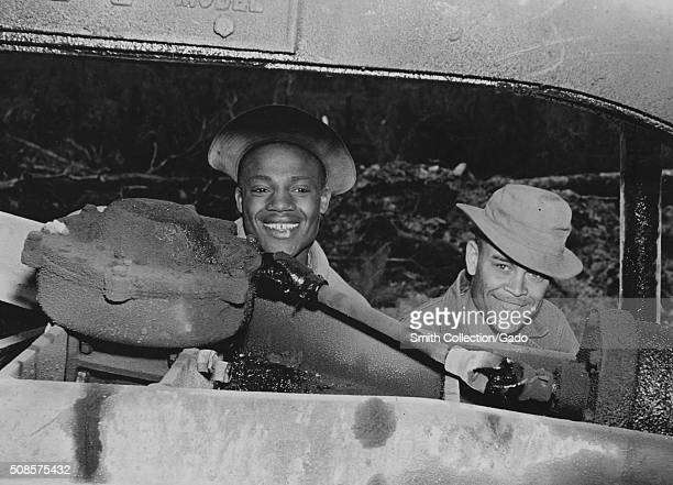 Two soldiers Private James A Jackson of Kearneysville West Virginia and Private First Class Willie Lee Jell of Baton Rouge Louisiana making repairs...