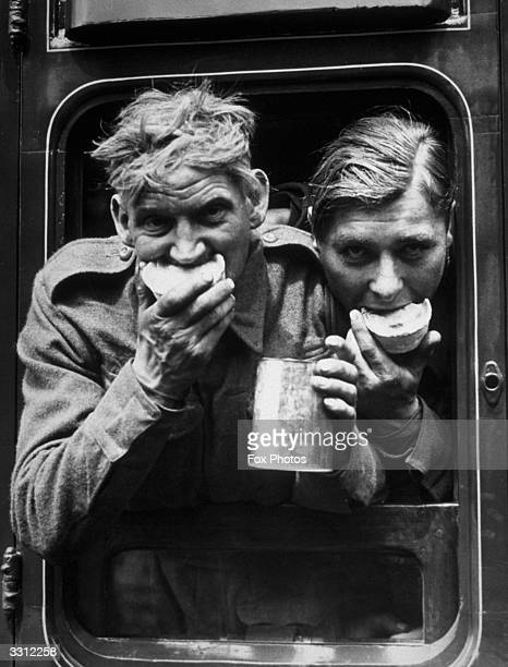 Two soldiers tuck in to the food and refreshment they received after their arrival in Britain after evacuation from Dunkirk