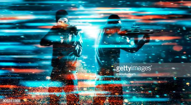 two soldiers with rifles stands in a video game like scene - violence stock photos and pictures