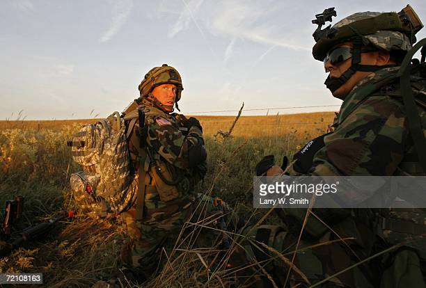 Two soldiers with the 3rd Platoon Company A 2nd Battalion 16th Infantry wait for orders during a ground attack into the Smoky Hill training range to...